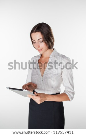 Young business woman standing with laptop on white background