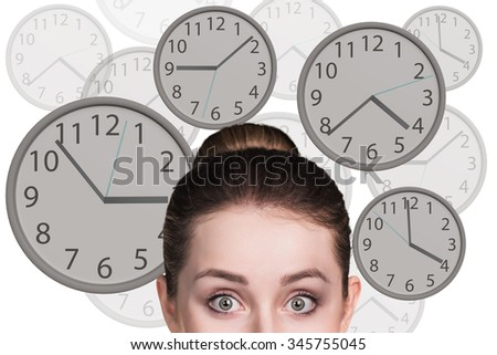 Young business woman stands among big clocks - stock photo