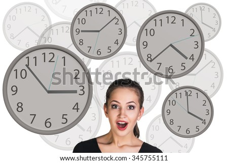 Young business woman stands among big clocks.  - stock photo