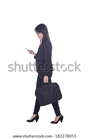 young business woman talking on the phone and holding a brief case while walking on white background  - stock photo
