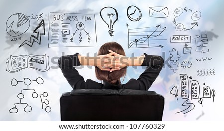 Young business woman thinking of her plans - stock photo