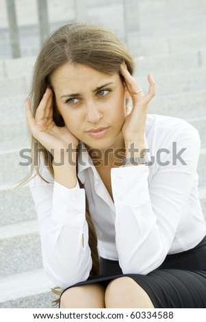 Young business woman tormented by headaches cares about the work - stock photo