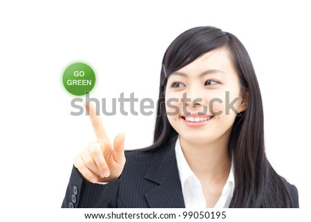 "young business woman touching ""go green"" button with her finger, isolated on white background"