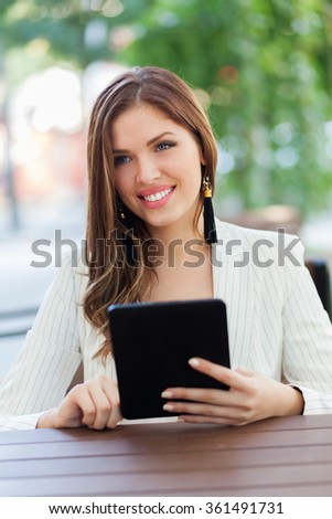 Young business woman using a tablet