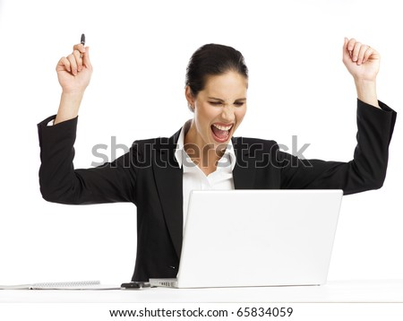 Young business woman very exited looking at a laptop - stock photo