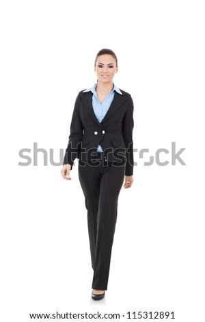 young business woman walking towards camera and smiling in full length on white background