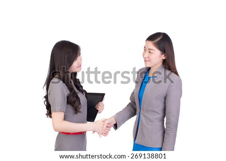 young business woman wear grey suit shaking hands with a business woman against on white background - stock photo