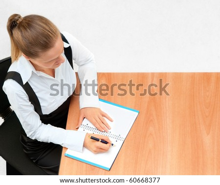Young business woman while at work - stock photo