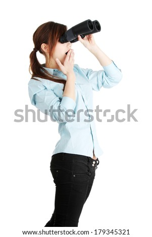 Young business woman with binocular isolated on white background