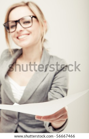 young business woman with blank white card - place for your text - stock photo