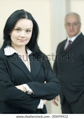 young business woman with colleague behind her, selective focus - stock photo