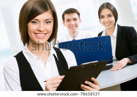 Young business woman with colleagues - stock photo