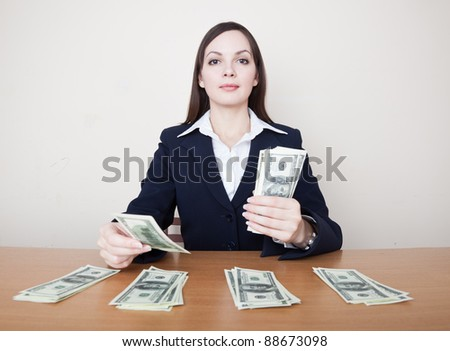 Young business woman with dollars - stock photo