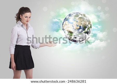 Young business woman with earth and cloud concept