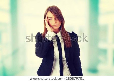 Young business woman with headache, isolated - stock photo