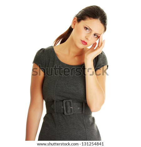 Young business woman with headache, isolated on white background - stock photo