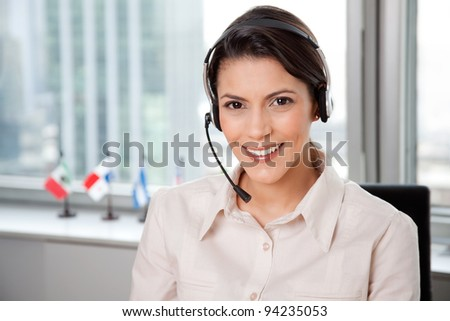 Young Business Woman With Headset In Office. - stock photo