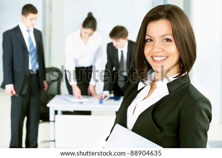 Young business woman with her colleagues - stock photo