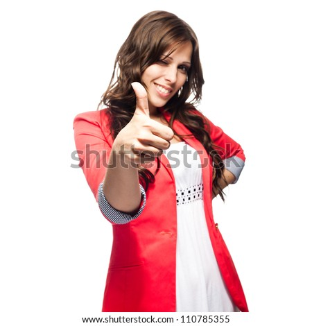 Young business woman with her thump up. Focus on hand - stock photo