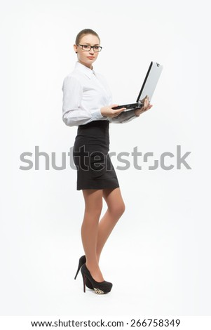 young business woman with laptop on light background. Full height. - stock photo