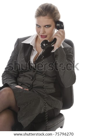 Young business woman with lip piercing in a gray business suit and high heels is angry on the phone, isolated on a white background - stock photo