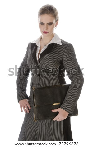 Young business woman with lip piercing in a gray business suit and high heels, isolated on a white background - stock photo