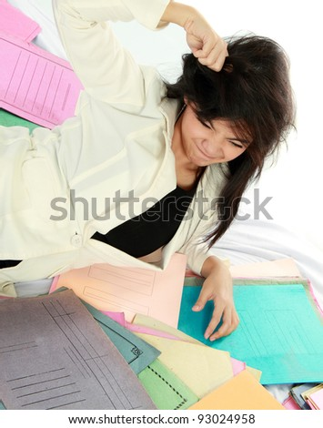 young business woman with many paper stressed on the bed - stock photo