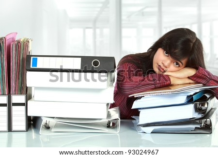 young business woman with many paper work stressed at work - stock photo