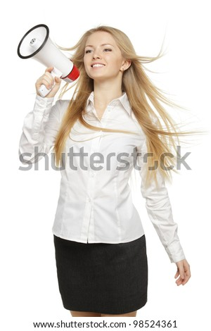 Young business woman with megaphone, over white background - stock photo