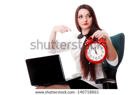 Young business woman with red clock white background. Deadline time management concept - stock photo