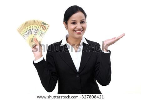 Young business woman with rupee notes in her hands