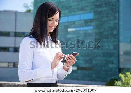 young business woman with smartphone in city - stock photo