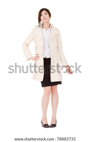 Young business woman with winter coat, full length portrait isolated on white background. - stock photo
