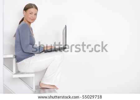 Young business woman work on laptop at modern house - stock photo