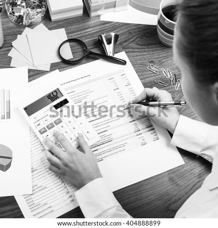 Young business woman working in office - stock photo