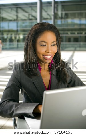 Young business woman working on her laptop
