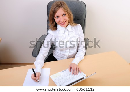 young business woman working on the computer. - stock photo