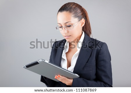 Young business woman working with a tablet - stock photo