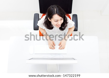 young business woman working with computer at office - stock photo