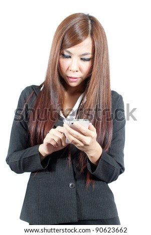 Young business woman working with mobile - stock photo