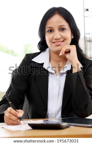Young business woman working with tablet computer at office