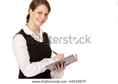 Young business woman writes on notepad. Isolated on white background. - stock photo