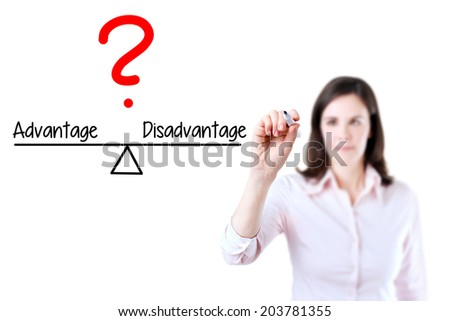 Young business woman writing advantage and disadvantage compare on balance bar. Isolated on white background. - stock photo