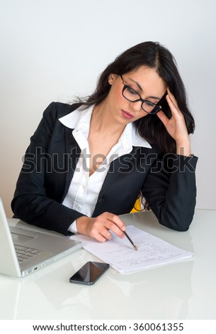 young business woman writing at office - stock photo