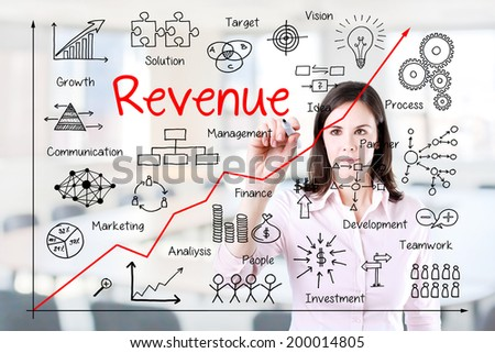 Young business woman writing increased revenue graph with process of vision - teamwork - plan - investment - management - research - development - strategy -marketing. Office background.  - stock photo