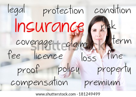Young business woman writing insurance concept. Office background. - stock photo