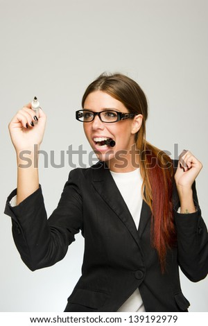 Young business woman writing on white background