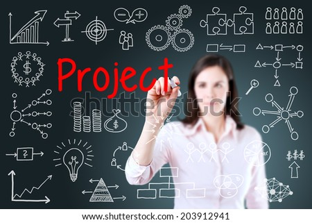 Young business woman writing project concept. Blue background.