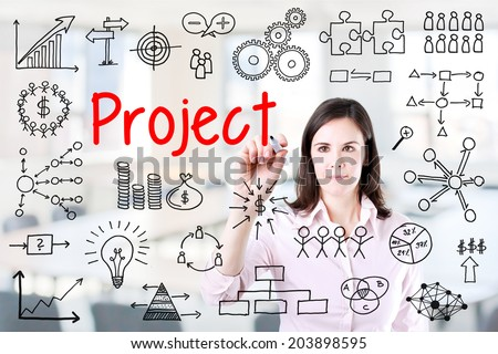 Young business woman writing project concept. Office background. - stock photo