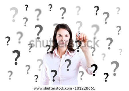 Young business woman writing question mark. Isolated on white.